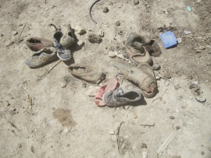 discarded traditional Mustangi shoes, Chinese slippers and trainers - village near Jhong cave stage 4 @ Roger Henke