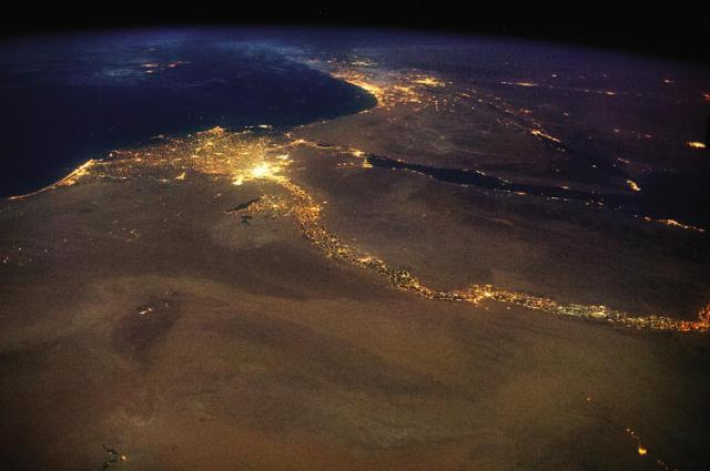 The End: The Nile, draining out into the Mediterranean. The bright lights of Cairo announce the opening of the north-flowing river's delta, with Jerusalem's answering high beams to the northeast. This 4,258 mile braid of human life, first navigated end-to-end in 2004, is visible in a single glance from space source: http://www.fastcoexist.com/3038117/stunning-photos-of-one-idealized-orbit-around-the-earth?utm_source=mailchimp&utm_medium=email&utm_campaign=coexist-weekly&position=4&partner=newsletter&campaign_date=11132014#10