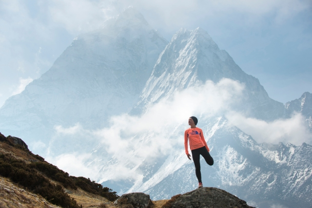 Lizzy running with Ama Dablam in the background Credit: Alex Treadway